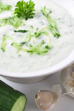 tzatziki: Fresh tzatziki in a bowl. Stockfoto