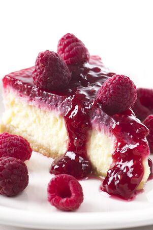 Raspberry cheesecake on a plate. Stock fotó