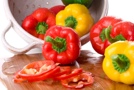a colander: Bell peppers in a colander.