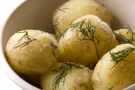 stirred: Prepared new potato with stirred butter and dill.