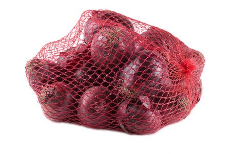 Red onions in a net bag.