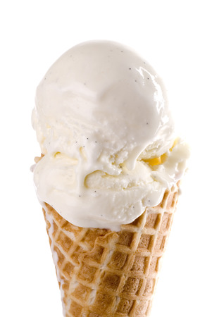 vanilla ice cream: Vanilla ice cream waffle cone close up.