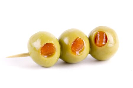 pimento: Three green pimento olives on a cocktail stick.