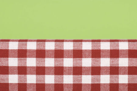 checked fabric: Red and white checked fabric with green background.