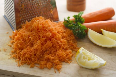 Grated carrot, sliced lemon and parsley.