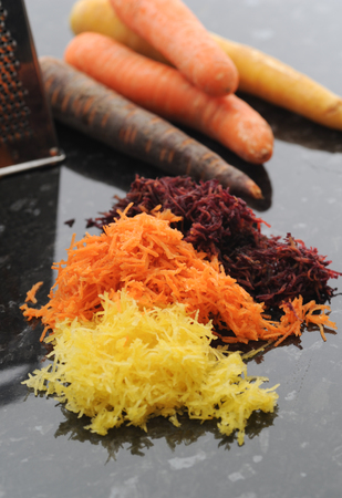 Grated carrot. Yellow, orange and purple.