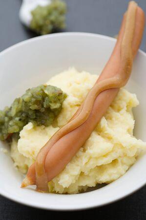 mash: Boiled sausage with homemade mash and sweet pickle relish. Stock Photo