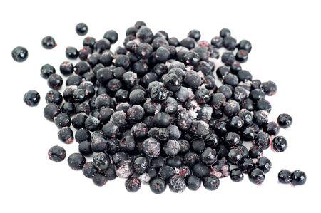 Organic frozen aronia berries on white background