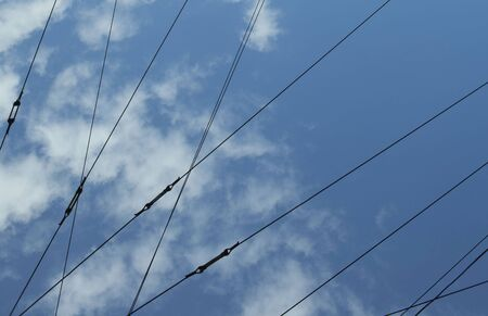 Abstract pattern using power lines, shining sky and clouds Banque d'images - 130785930