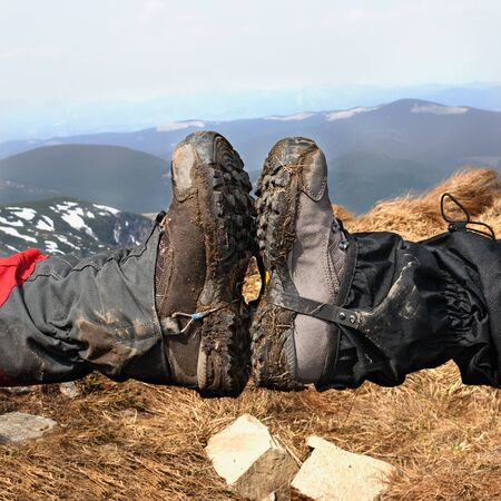 give me five: Give me five by legs in dirty hiking shoes in the mountains