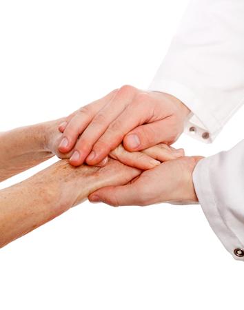 자신감이 의사는 환자의 손을 잡고있다