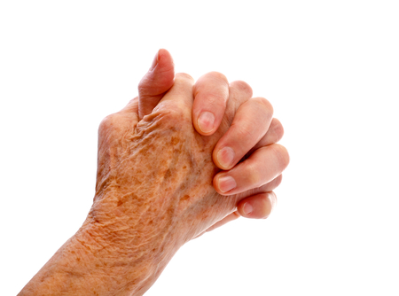 Elderly woman hand on an isolated background photo