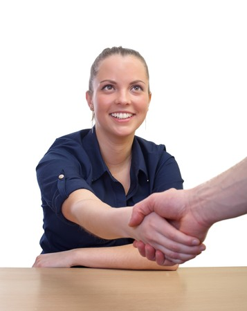 approvement: Businesswoman shaking hands over the table isolated Stock Photo