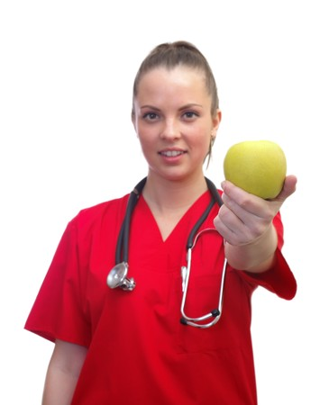 Portrait of a smiling female doctor holding an apple photo