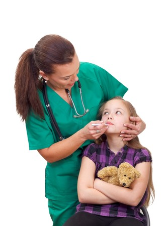 Portrait of a sick child with fever visiting the doctor Stock Photo - 26308288