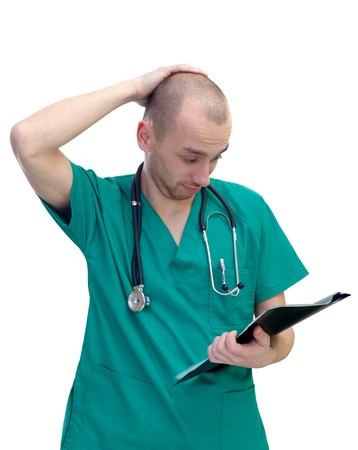 Portrait of a confident doctor reading medical record photo