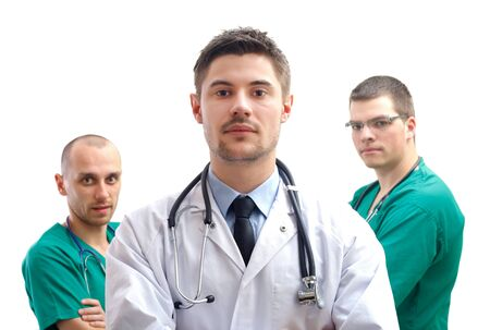 Portrait of a young male doctor with his  medical team photo