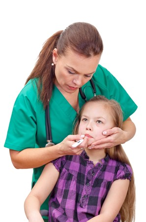 Portrait of a sick child with fever visiting the doctor Stock Photo - 26308003