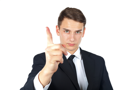 Confident businessman making stop gesture on isolated