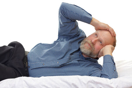 Portrait of an aged man suffering of headache photo