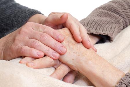 여자에 고립 된 노인의 손을 잡고 스톡 콘텐츠