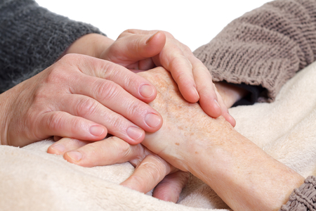 Woman holding elderly hands on isolated  Banque d'images