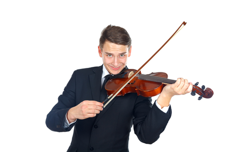 Confident soloist playing on his violin photo