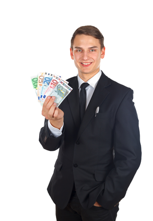 Portrait of a confident businessman holding a money after a deal Stock Photo - 26332038