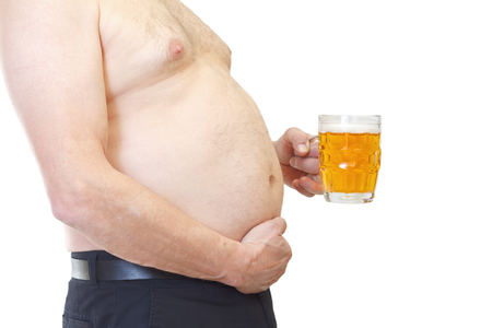 alcoholic man: Close up of an obese man holding a glass of beer