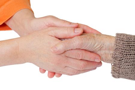 Vrouw die bejaarde handen op geïsoleerde achtergrond