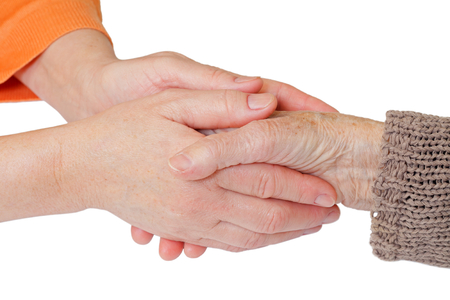 Woman holding elderly hands on isolated background Reklamní fotografie