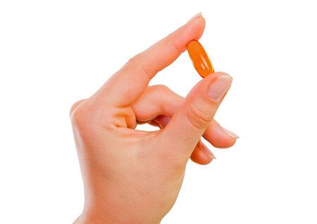 medicament: Cose plano de una mujer joven la mano que sostiene un medicamento Foto de archivo