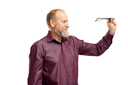 bifocals: Picture of an elderly man with vision problems Stock Photo