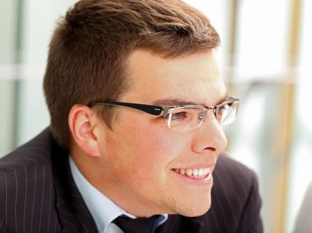 Picture of a confident businessman sitting in his office photo