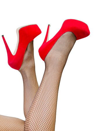 fishnet stockings: Picture of a womans leg in red high heels Stock Photo