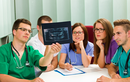 Picture of a medical team analyzing an X-ray