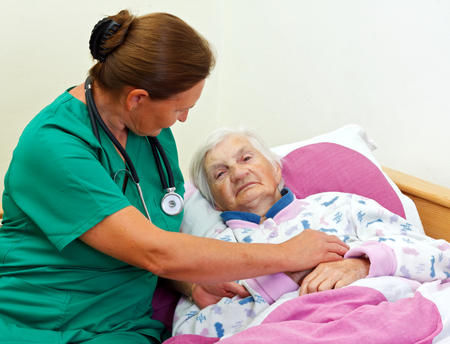giver: Caregiver with an elderly patient at home