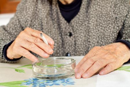 nicotine: Elderly woman addicted to nicotine and smoking