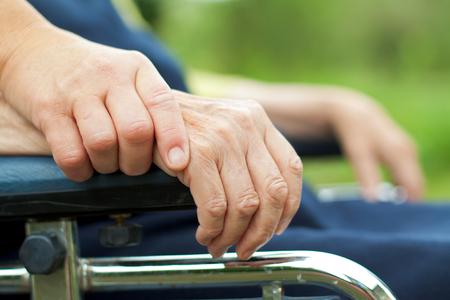 Handicapped elderly woman sitting in a wheelchair Standard-Bild