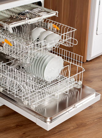 unwashed: Picture of an opened dishwasher in the kitchen