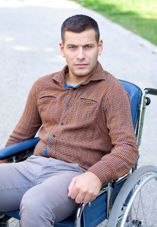 Picture of a handicap businessman with his wheelchair photo
