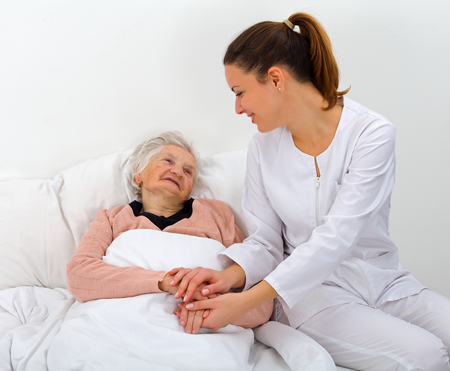 elderly person: Elderly woman with her caregiver at home