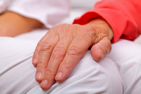 retirement homes: Elderly woman holding her aged and wrinkled hand