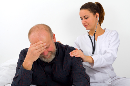 hypotension: Elderly man with his caregiver at home