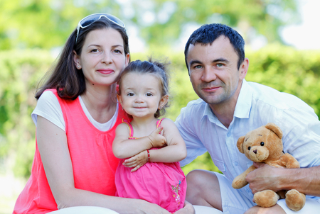female child: Beautiful young couple playing with their daughter Stock Photo