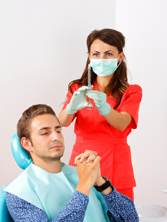 anesthesia: Scared dental patient receiving anesthesia injection
