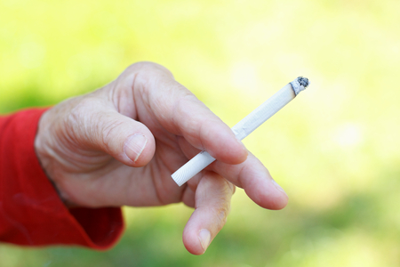 nicotine: Elderly woman addicted to nicotine and smoking