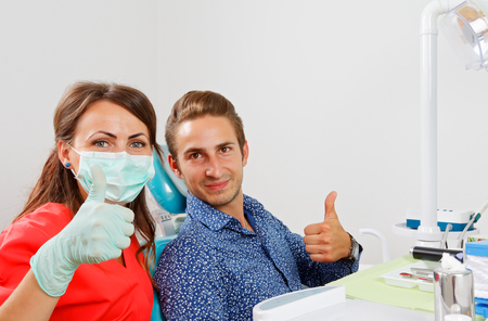 The dentist is checking the patients mouth