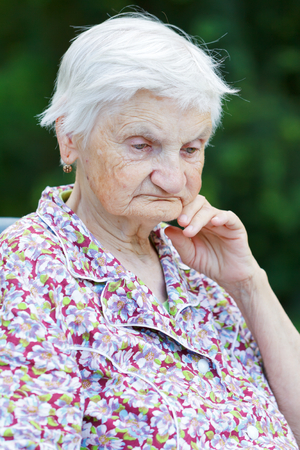 elderly: Portrait of an unhappy elderly woman