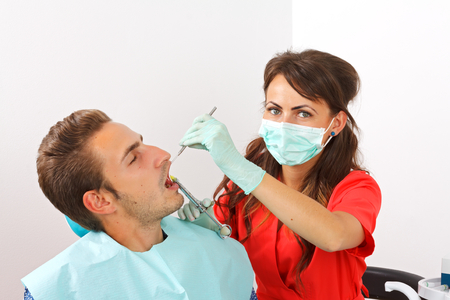 dental calculus: Scared dental patient receiving anesthesia injection